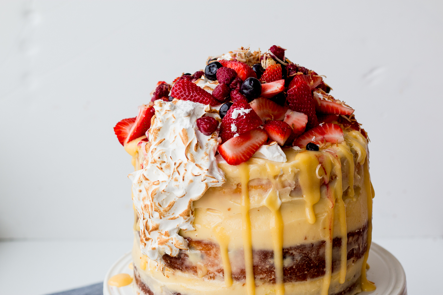 Lemon, Coconut & Berry Layer Cake with Lemon Curd and Torched Meringue ...